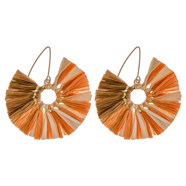 """Two-tone raffia inspired tassel earrings featuring gold accents. Approximately 2"""" in diameter."""