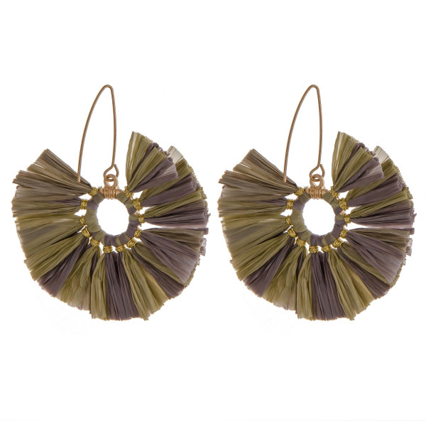 "Two-tone raffia inspired tassel earrings featuring gold accents. Approximately 2"" in diameter."