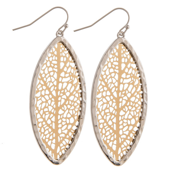 """Long metal earrings featuring a filigree tree inspired pattern. Approximately 2"""" in length."""