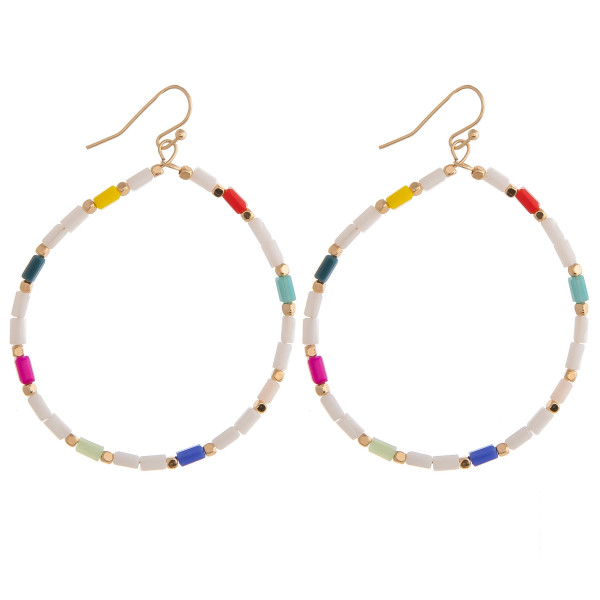 "Large circular earrings featuring beaded details and gold accents. Approximately 2"" in diameter."