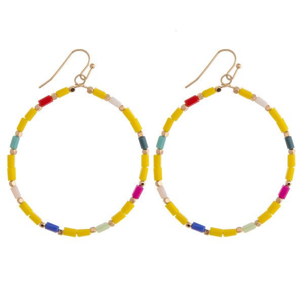 """Large circular earrings featuring beaded details and gold accents. Approximately 2"""" in diameter."""