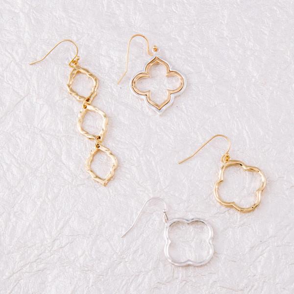 "Clover inspired metal earrings. Approximately 1"" in length."