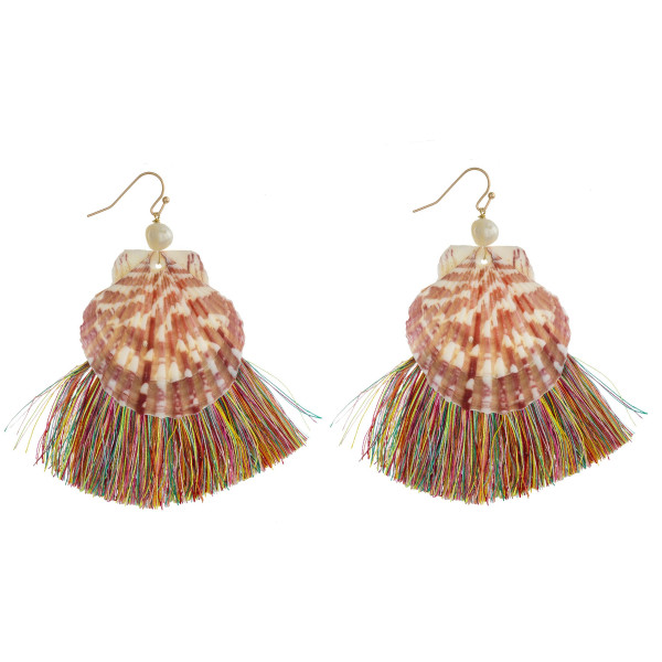 "Large seashell earrings featuring tassel details and pearl accents. Approximately 3.5"" in length."