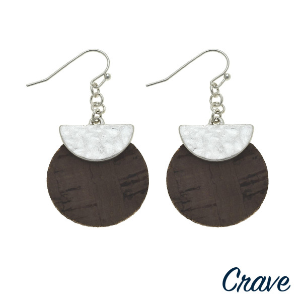 "Cork inspired disc earrings featuring a metal accent. Approximately 1.5"" in length."