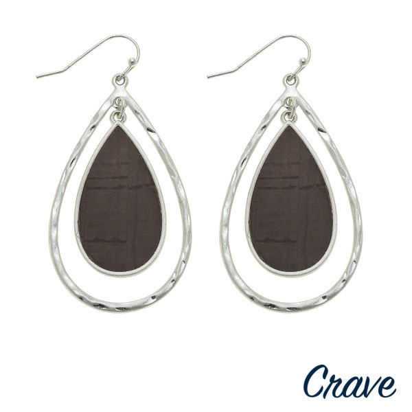"Double teardrop earrings featuring a cork inspired center detail. Approximately 2"" in length."