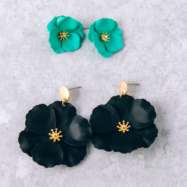 "Metal flower stud earrings featuring a gold center accent. Approximately 1"" in diameter."