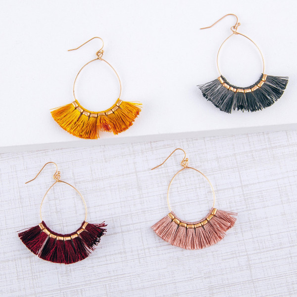 "Dainty teardrop earrings featuring tassel details with gold accents. Approximately 2"" in length."