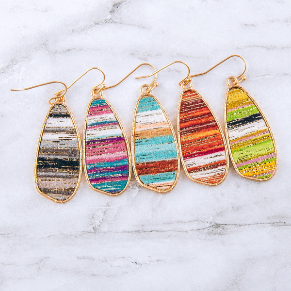 "Metal teardrop inspired earrings featuring a multicolor fabric center accent with metallic details. Approximately 2"" in length."