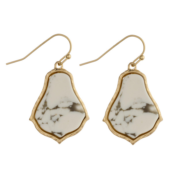 """Metal drop earrings featuring a natural stone inspired center detail. Approximately 1"""" in length."""