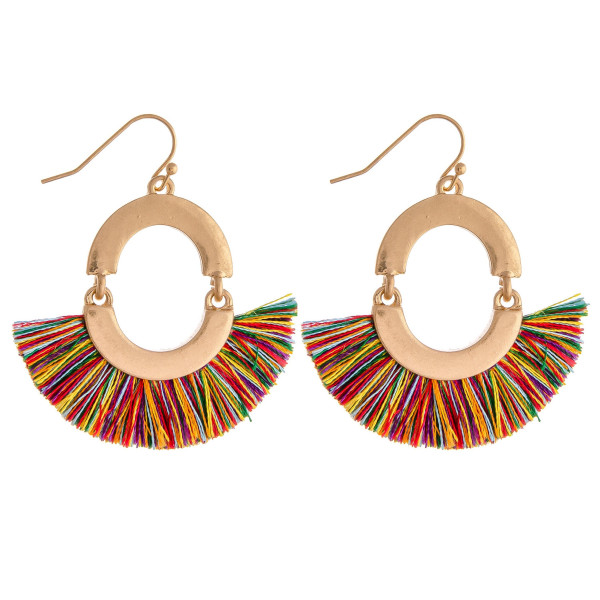 "Drop earrings featuring tassel details and gold metal accents. Approximately 2"" in length."