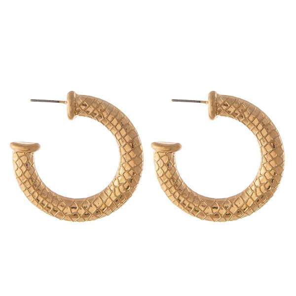 """Metal hoop earrings featuring a mermaid scale inspired pattern details with a stud post. Approximately 1.5"""" in diameter."""