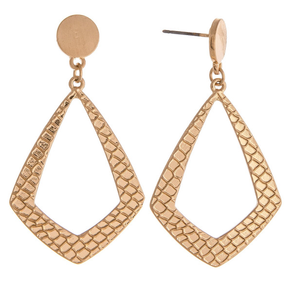 """Metal drop earrings featuring snakeskin inspired details and a stud post. Approximately 1.5"""" in length."""