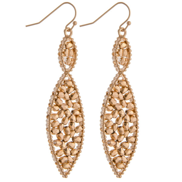 "Pointed oval drop earrings with beaded center details. Approximately 2.5"" in length."