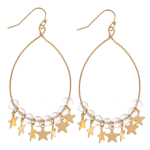 "Brass plated teardrop earrings featuring iridescent beaded details and star accents. Approximately 3"" in length."