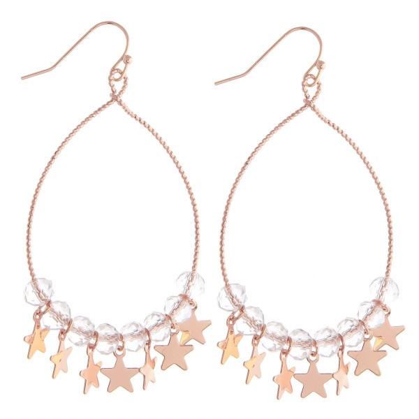 """Brass plated teardrop earrings featuring iridescent beaded details and star accents. Approximately 3"""" in length."""