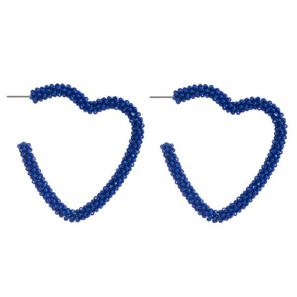 "Seed beaded open heart hoop earrings featuring a stud post. Approximately 2"" in diameter."