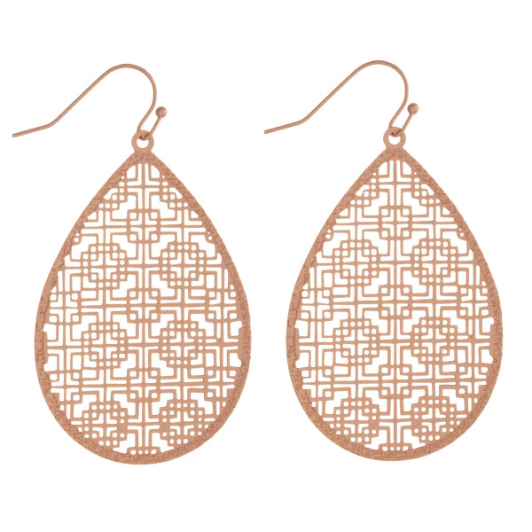 "Long metal, filigree inspired teardrop earrings. Approximately 2"" in length."