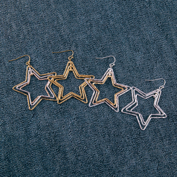 "Two tone metal multi layered star earrings. Approximately 2"" in length."