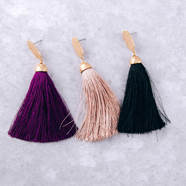 "Long tassel drop earrings featuring hammered metal accents. Approximately 3.5"" in length"