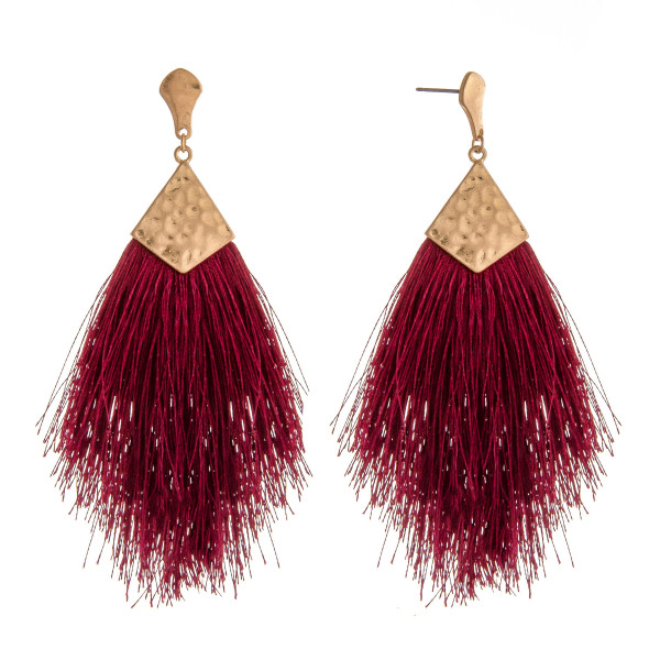 "Long tassel drop earrings featuring hammered metal accents. Approximately 4"" in length."
