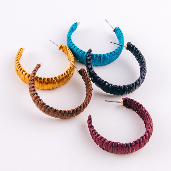 "Raffia wrapped hoop earrings. Approximately 1.5"" in diameter."