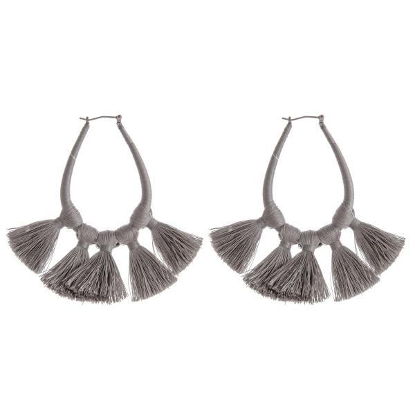"""Thread wrapped teardrop hoop earrings featuring fan tassel details. Approximately 3"""" in length."""