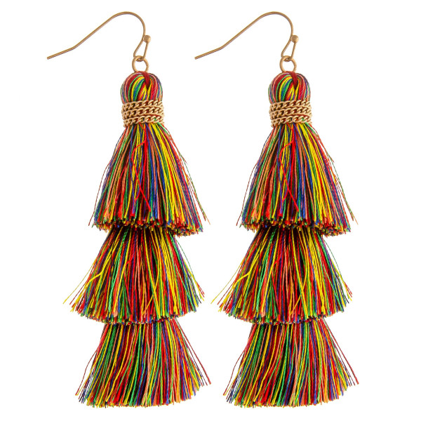 "Long fanned tassel earrings featuring chain link wrapped details. Approximately 3"" in length."