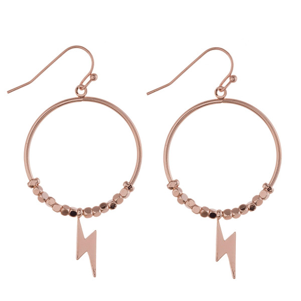 "Circular metal earrings featuring beaded details with a lightning bolt accent. Approximately 2"" in length."