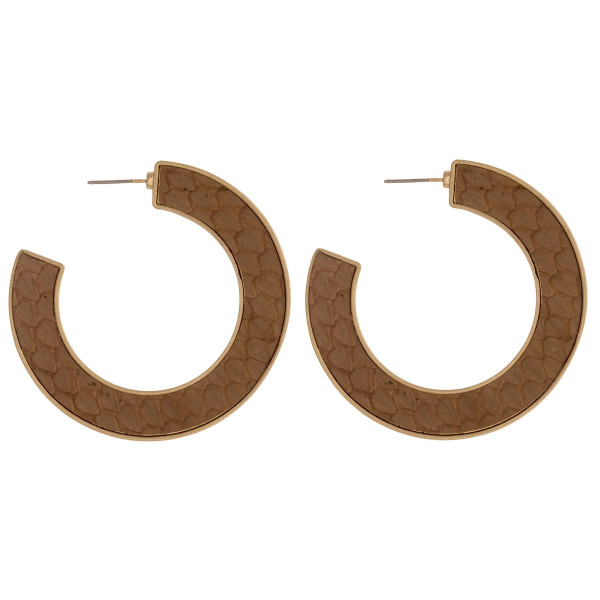 """Open hoop metal earrings featuring genuine leather snakeskin details and a stud post. Approximately 2"""" in diameter."""