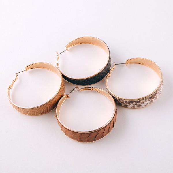 "Large hoop earrings featuring genuine leather snakeskin details. Approximately 2"" in diameter."