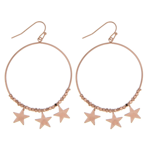 """Metal circular earrings featuring beaded details with star accents. Approximately 2.5"""" in length."""