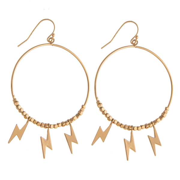 "Metal circular earrings featuring beaded details with lightning bolt accents. Approximately 2.5"" in length."