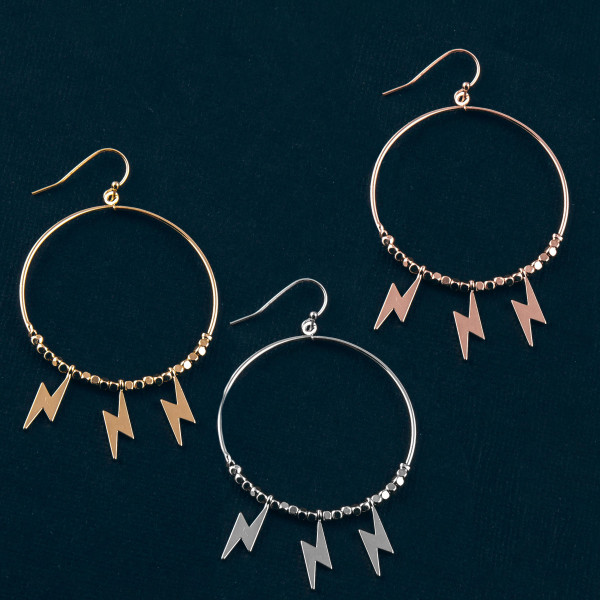 """Metal circular earrings featuring beaded details with lightning bolt accents. Approximately 2.5"""" in length."""