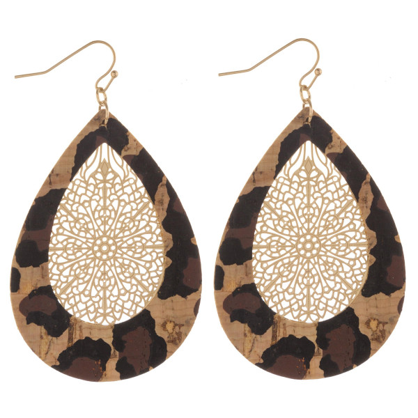 "Cork inspired teardrop earrings featuring filigree center details. Approximately 2.5"" in length."