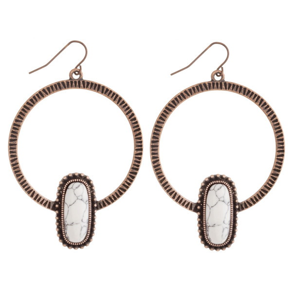 """Western style metal earrings featuring a natural stone accent. Approximately 2.75"""" in length."""