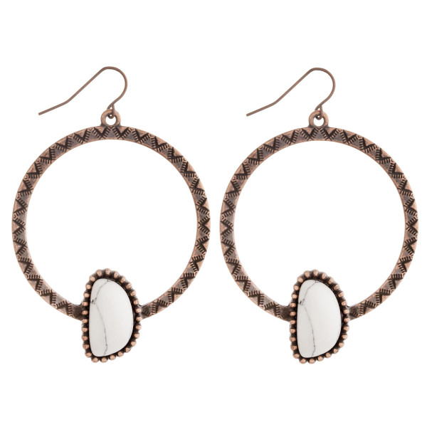 """Western style metal earrings featuring a natural stone accent. Approximately 2.5"""" in length."""