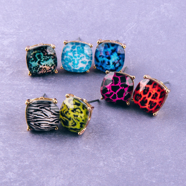 Gold stud earrings featuring a iridescent acrylic stone leopard print details. Approximately 1cm in diameter.