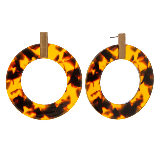 """Circular resin inspired drop earrings featuring tortoise shell details and a gold metal accent. Approximately 2"""" in length."""