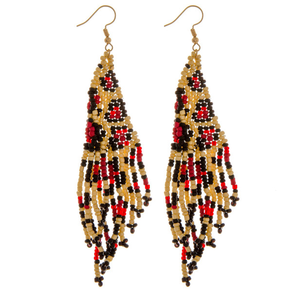 "Seed beaded tassel earrings featuring leopard print details. Approximately 3"" in length."