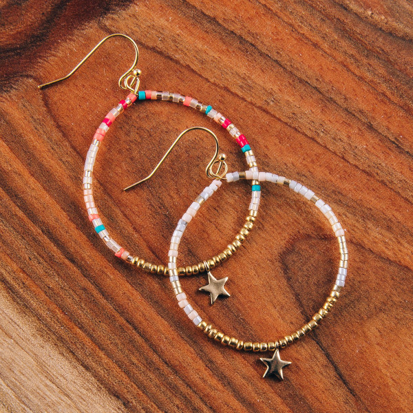 "Dainty circular beaded earrings featuring multicolor seed bead details and a star accent. Approximately 1.5"" in diameter."