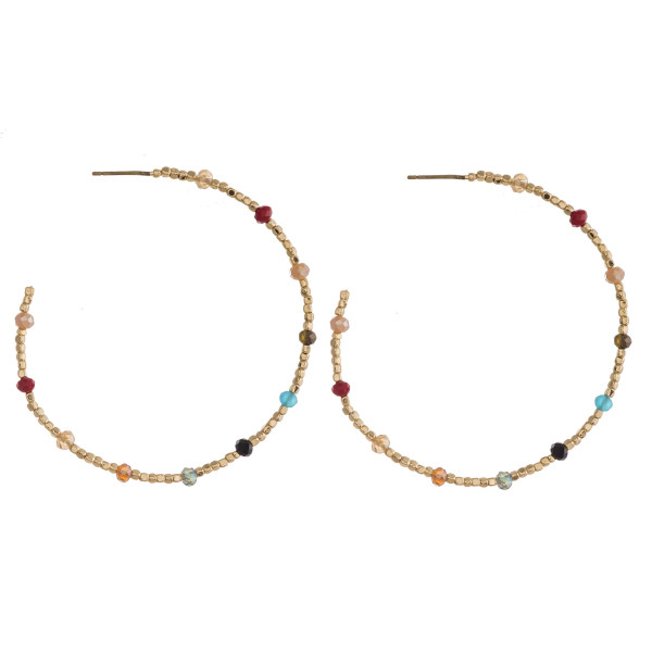 "Large dainty seed beaded hoop earrings featuring faceted bead accents. Approximately 2"" in diameter."