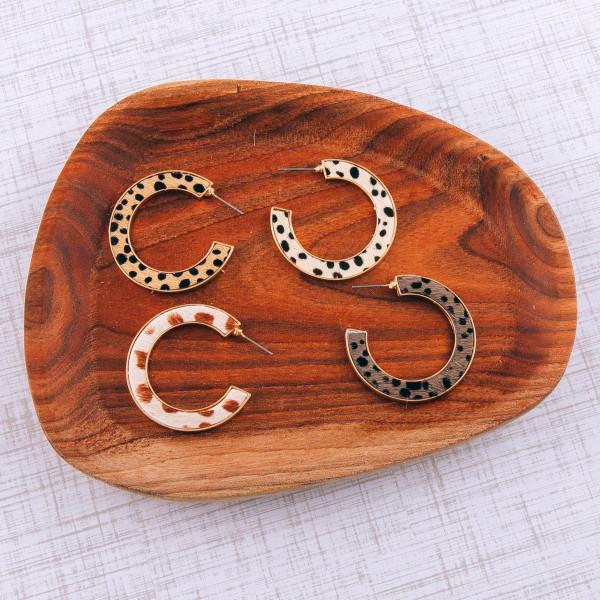 """Fur genuine leather open hoop earrings featuring cheetah print details. Approximately 1.5"""" in diameter."""