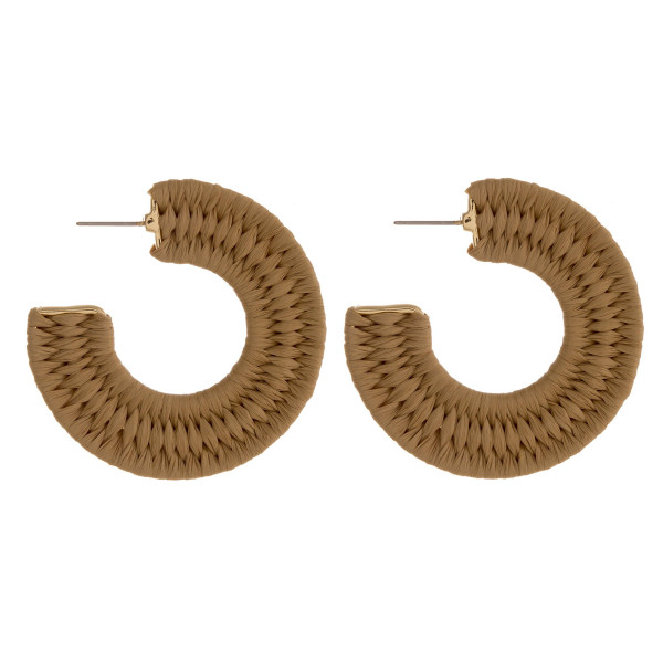 "Raffia wrapped open hoop earrings featuring a stud post. Approximately 2"" in diameter."