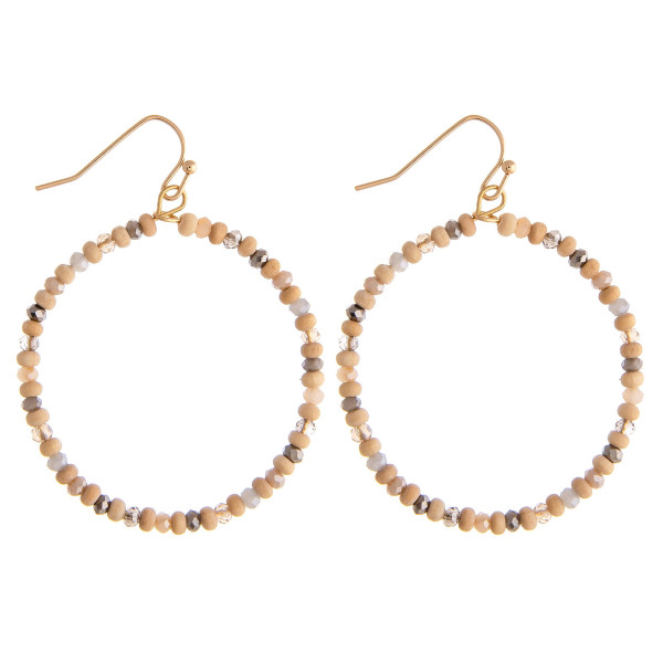 """Dainty circular beaded earrings featuring wood and multicolor faceted bead details. Approximately 1.5"""" in diameter."""