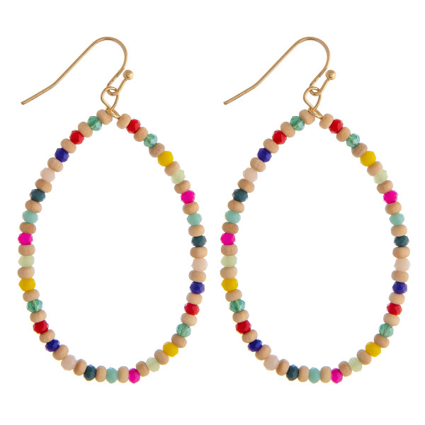 """Dainty beaded teardrop earrings featuring wood and faceted bead details. Approximately 2.5"""" in length."""