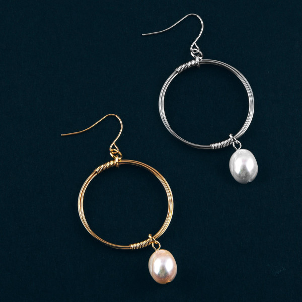 """Circular drop earrings featuring a pearl accent. Approximately 2"""" in length."""