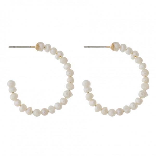 "Pearl beaded hoop earrings with a stud post. Approximately 1"" in diameter."
