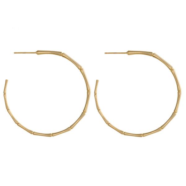 "Bamboo look metal open hoop earrings featuring a stud post. Approximately 1.5"" in diameter."