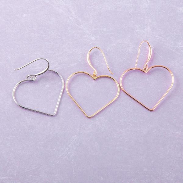 """Metal heart drop earrings. Approximately 1.5"""" in length."""