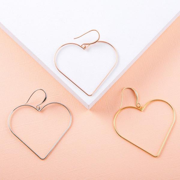 """Metal heart drop earrings. Approximately 2.5"""" in length."""